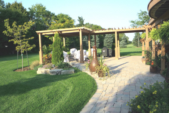 Large pergola extends out into the grounds for elegant outdoor dining.